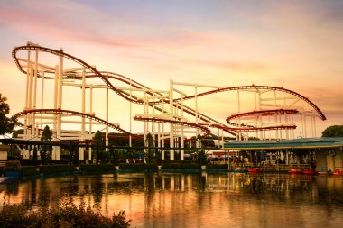 Roller Coaster loops in the sunset.