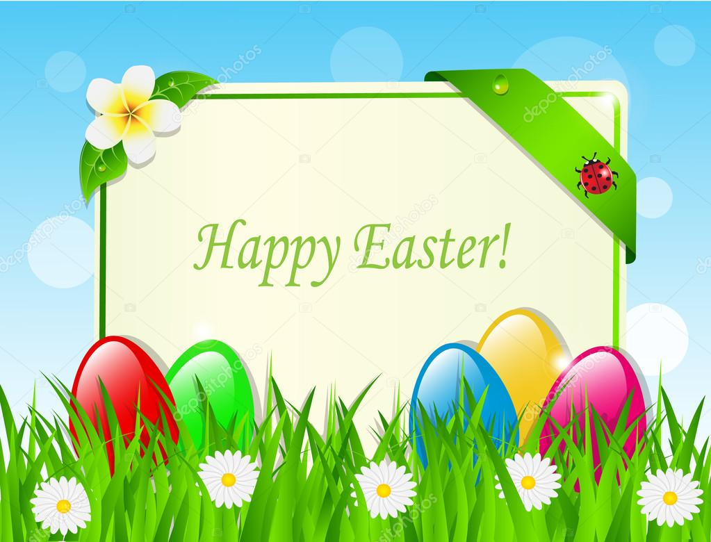 Easter eggs and card in the grass
