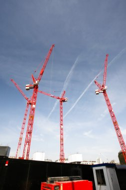 Multiple cranes at construction site