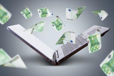 Euro Banknotes Flying around Laptop