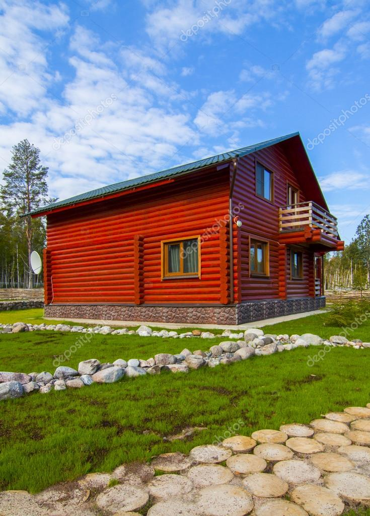 red wooden house in the village