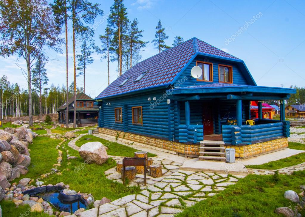 blue wooden house in the village