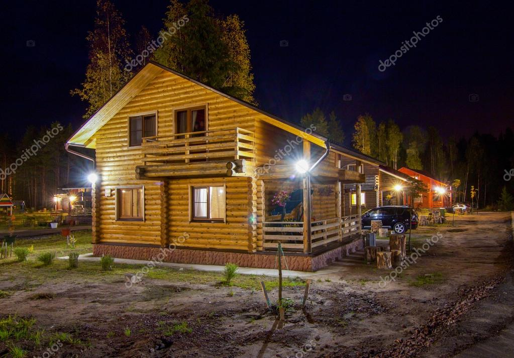 wooden house in the village at night