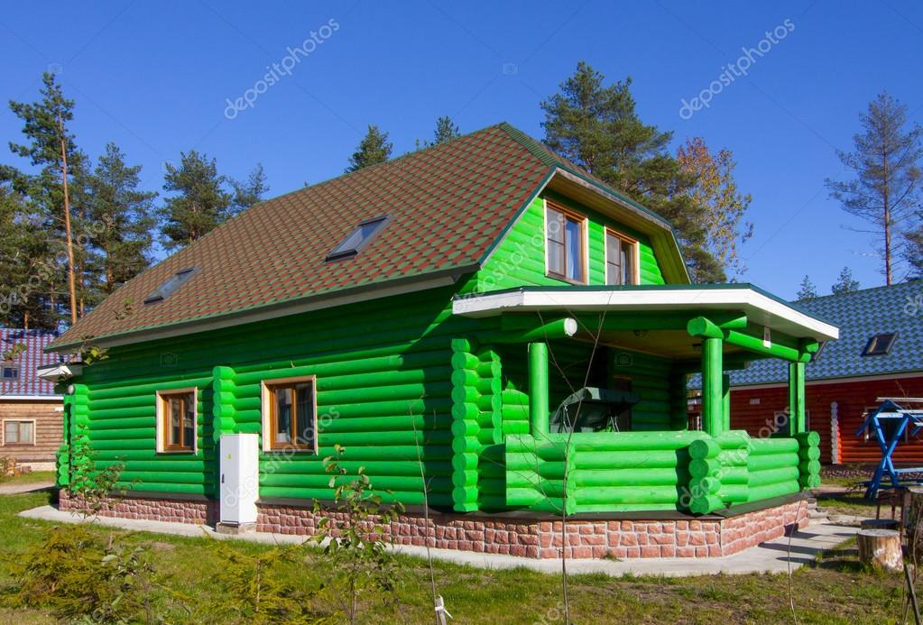 green wooden house in the village