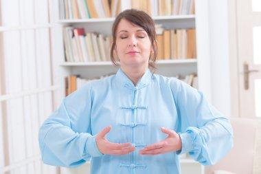 Meditating woman at home