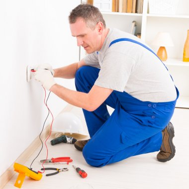 Electrician checking socket