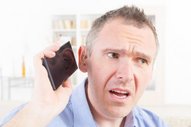 Hearing impaired man using mobile phone