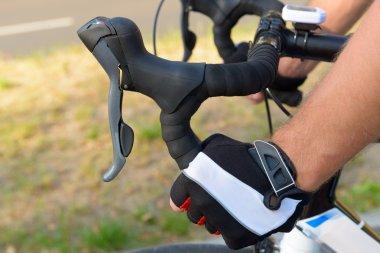 Hands on bicycle's handlebars