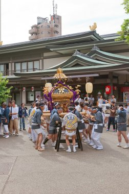 Omikoshi bearers in Yushima Tenmangu Shrine of Tokyo, Japan