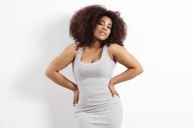 plus size woman in striped dress