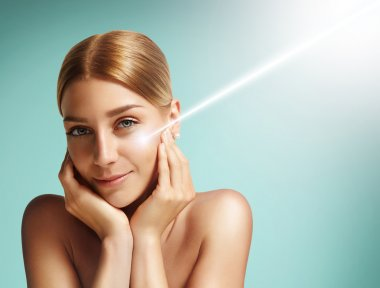Woman with  laser on her cheek