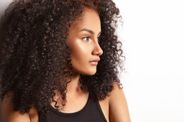 Latin woman with curly hair