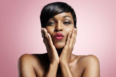 Black woman sending kiss