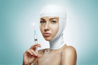 Woman holding botox injection