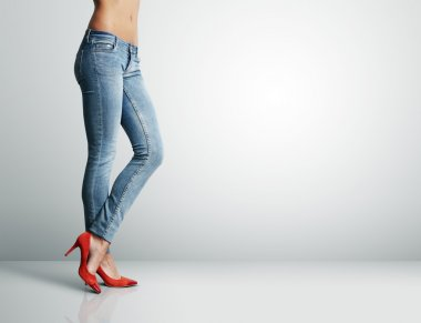 Woman in jeans showing ideal body