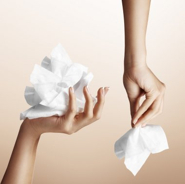 Hand with makeup remover wipes