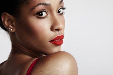 Woman wearing red matte lipstick