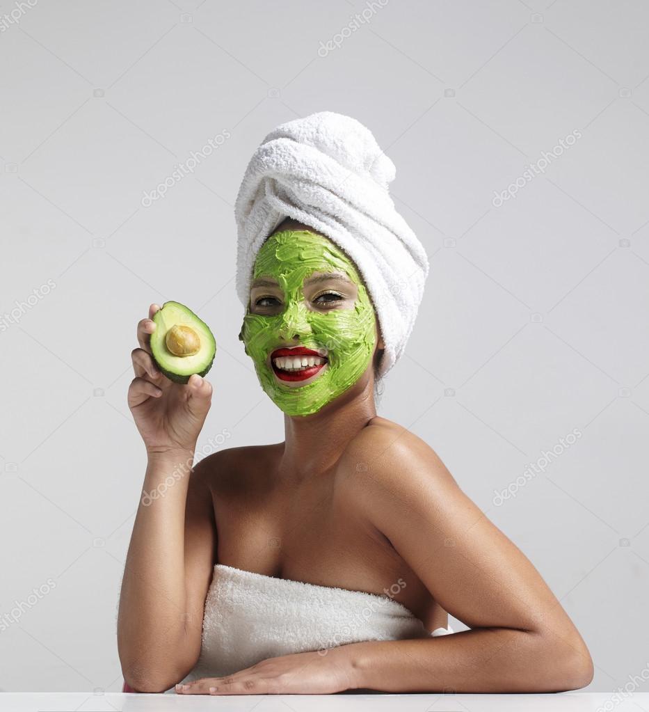 Woman with avocado facial mask