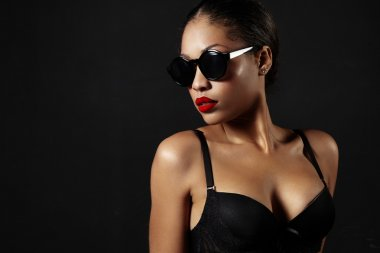 Woman in sunglasses with red lips