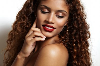 woman with curly hair and red lips