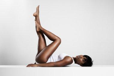 relaxing woman lying on plank