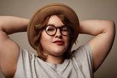 Fotografie Frau in Hut und Brille