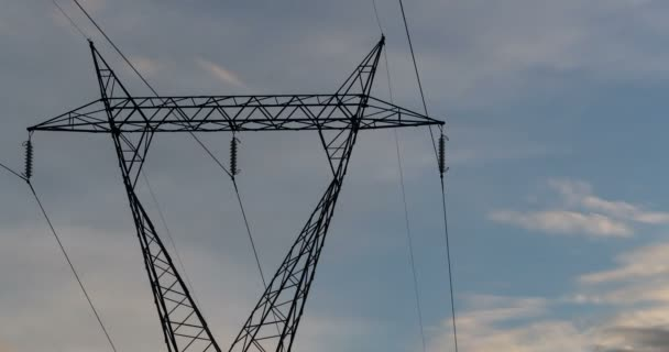 electric high voltage pylon, transmission tower with a light gray sky