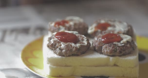 sandwich, The tramezzino with meatballs with ketchup and mayonnaise on a yellow plate