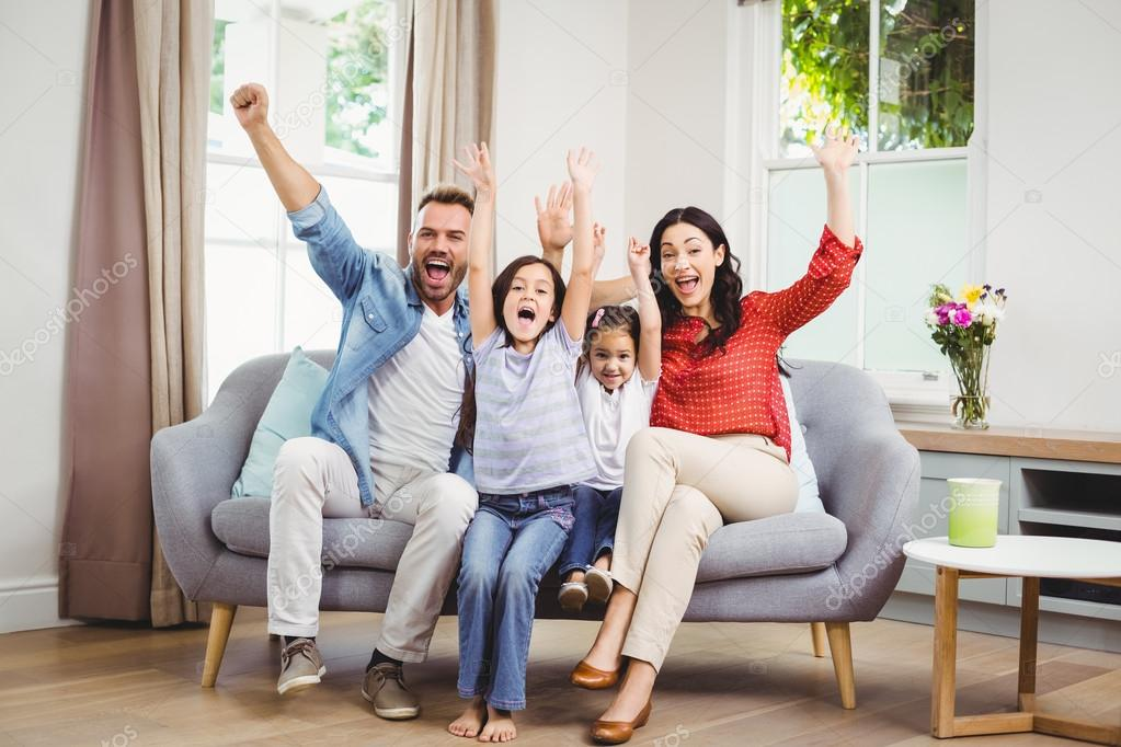 Family Cheering While Siting On Sofa U2014 Stock Photo