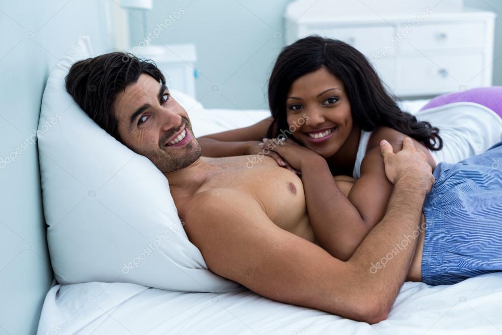 Romantic couple lying on bed   Stock Photo  106171112. Romantic couple lying on bed   Stock Photo   Wavebreakmedia  106171112