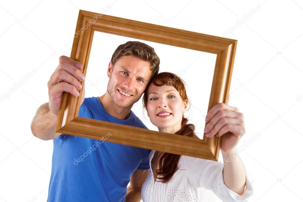 восторженно воспринята фотобанк держит раму какая радость