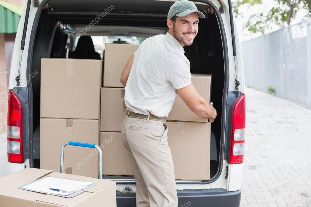 Delivery driver loading his van with boxes — Stock Photo ...