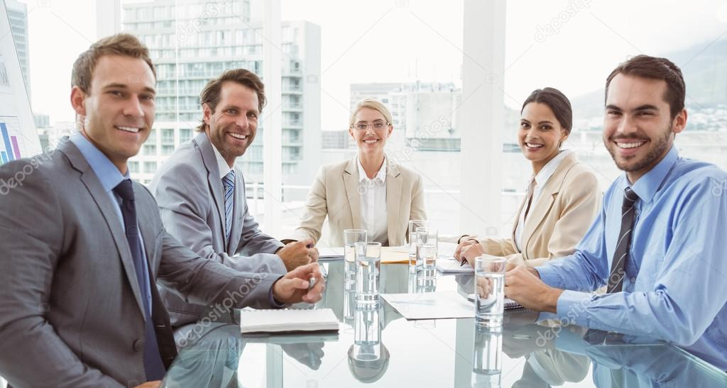 young business people in board room meeting � stock photo