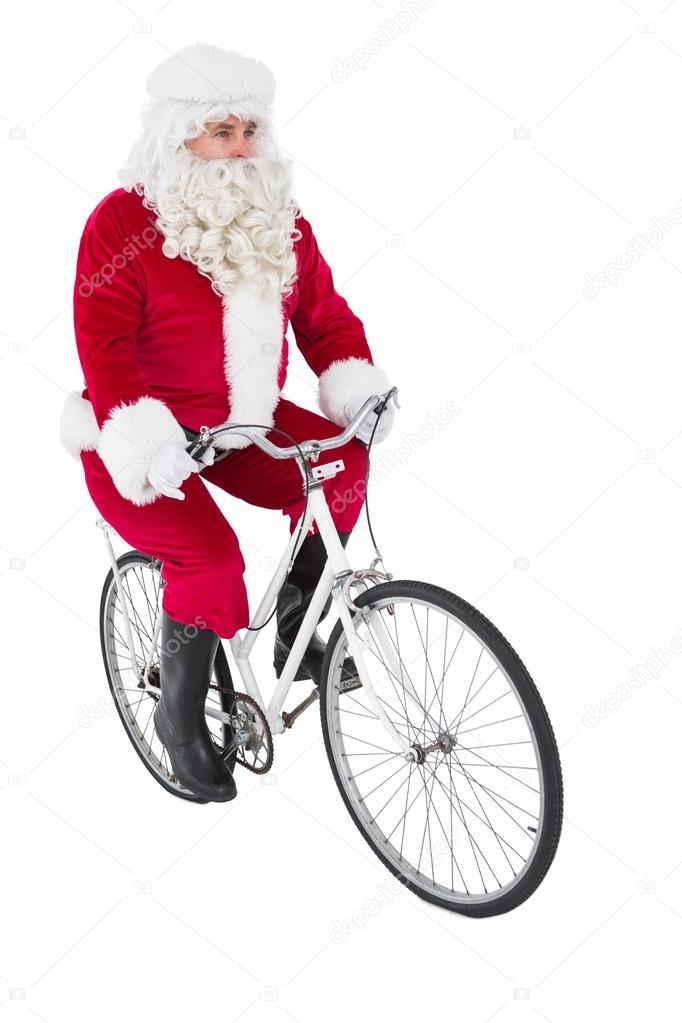 Babbo Natale In Bicicletta.Allegro Babbo Natale In Bicicletta Foto Stock C Wavebreakmedia