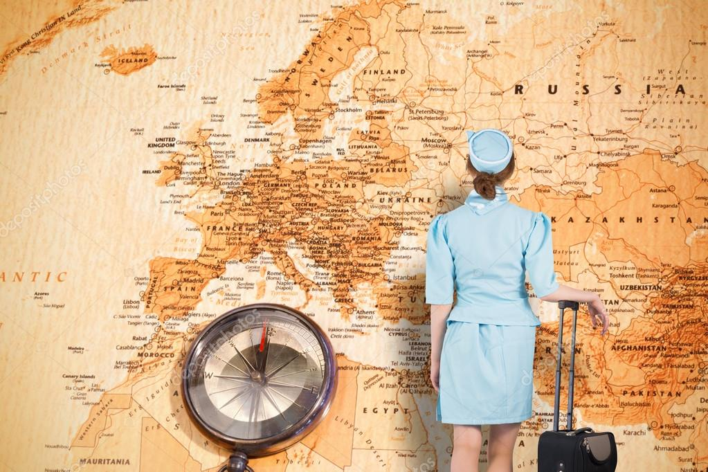 Pretty air hostess leaning on suitcase stock photo pretty air hostess leaning on suitcase against world map with compass showing europe and the middle east photo by wavebreakmedia gumiabroncs Gallery