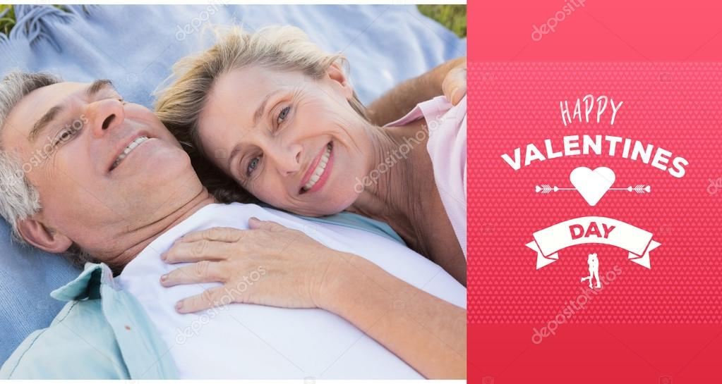 Happy Senior Couple Cuddling On Blanket Stock Photo