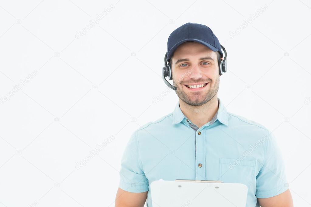 male worker wears headphones - 960×640