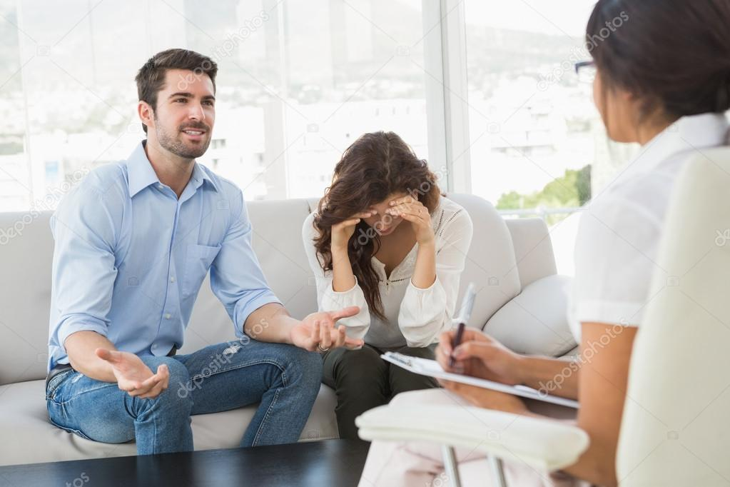 Couple Fighting Together In Front Of Therapist Stock Photo