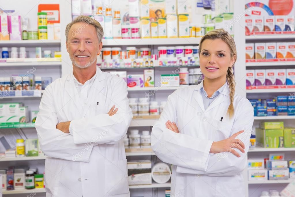 Pharmacist and his trainee with arms crossed — Stock Photo ...
