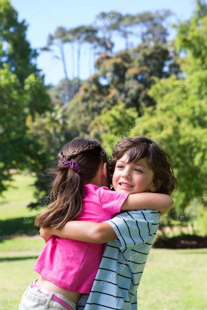 Happy Brother And Sister Hugging Each Other On Nice Day