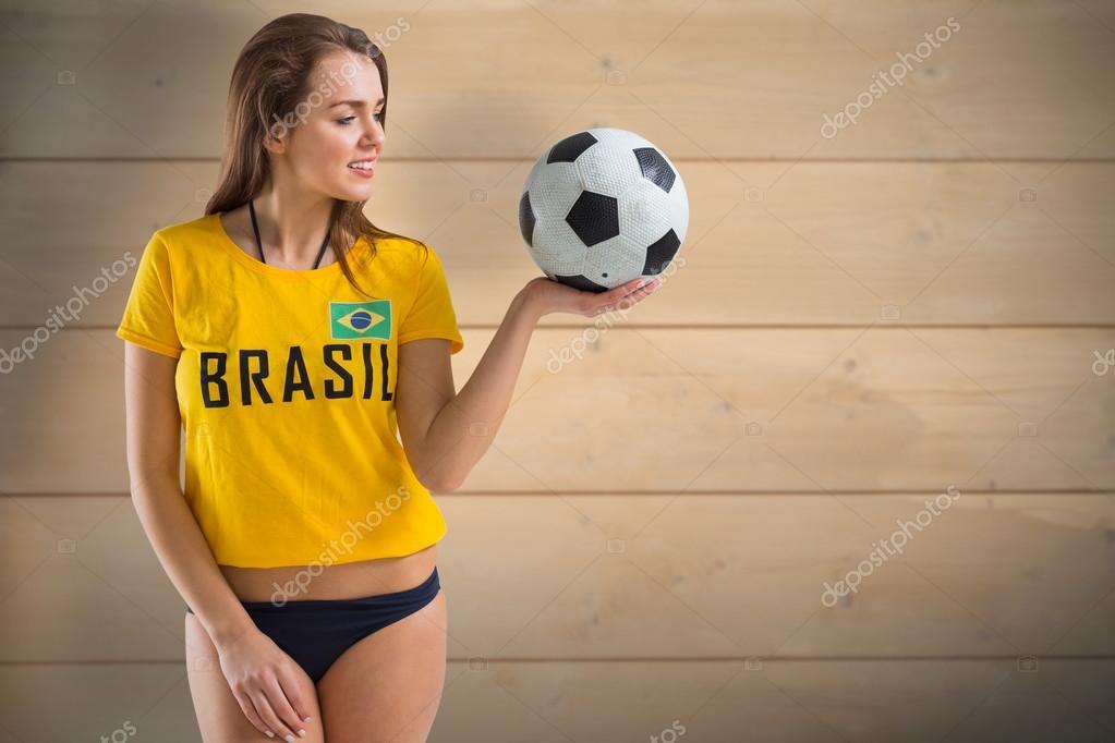 Pretty girl in bikini and brasil tshirt against bleached wooden planks  background — Εικόνα από Wavebreakmedia b53b39f4504