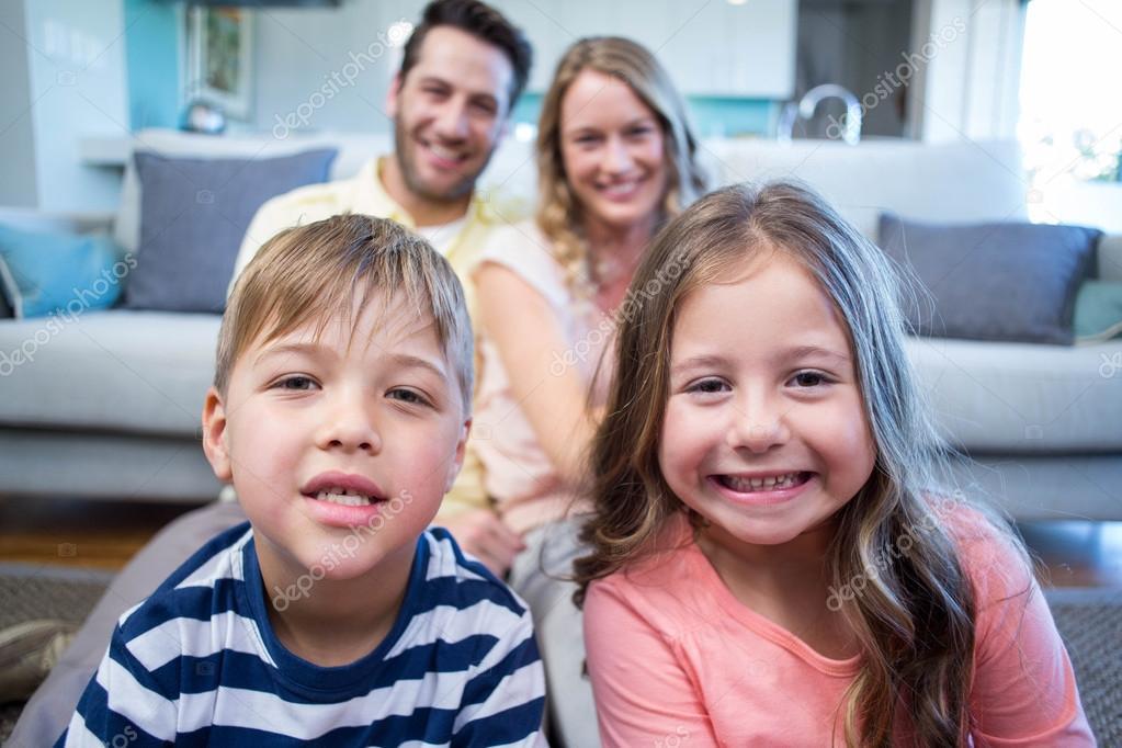 Happy family smiling at camera — Stock Photo © Wavebreakmedia #73273659