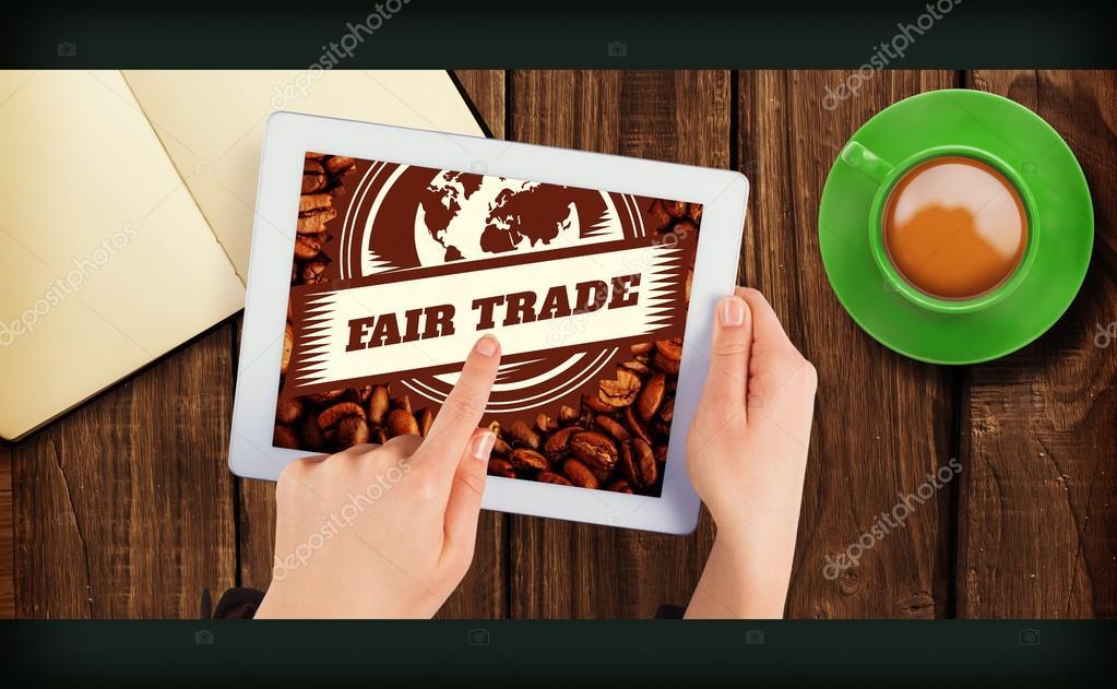 3dcc2c51ab2b Commerce équitable contre les mains tenant la tablette — Image de  Wavebreakmedia
