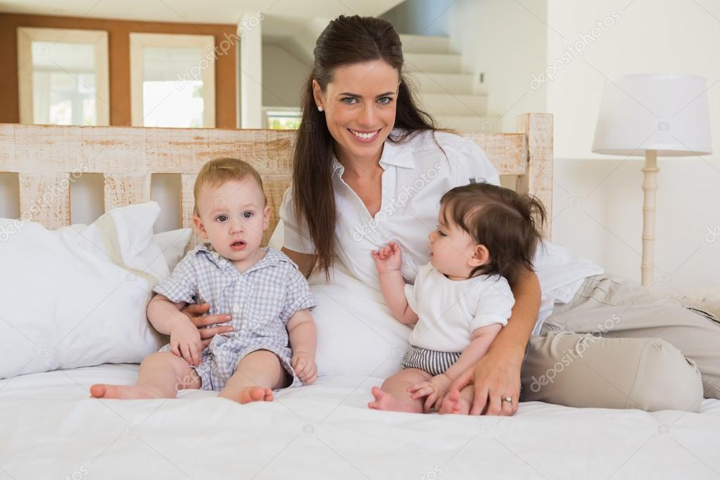 Mother With Cute Babies Stock Photo Wavebreakmedia 76624357