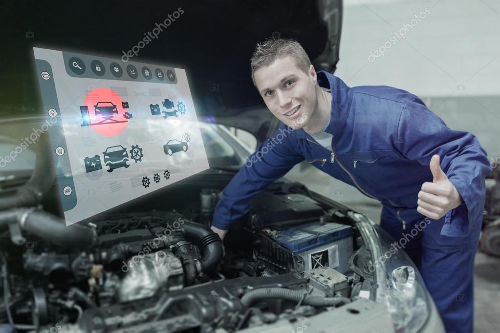 Mechaniker unter Auto Motorhaube Gestikulieren Daumen hoch ...