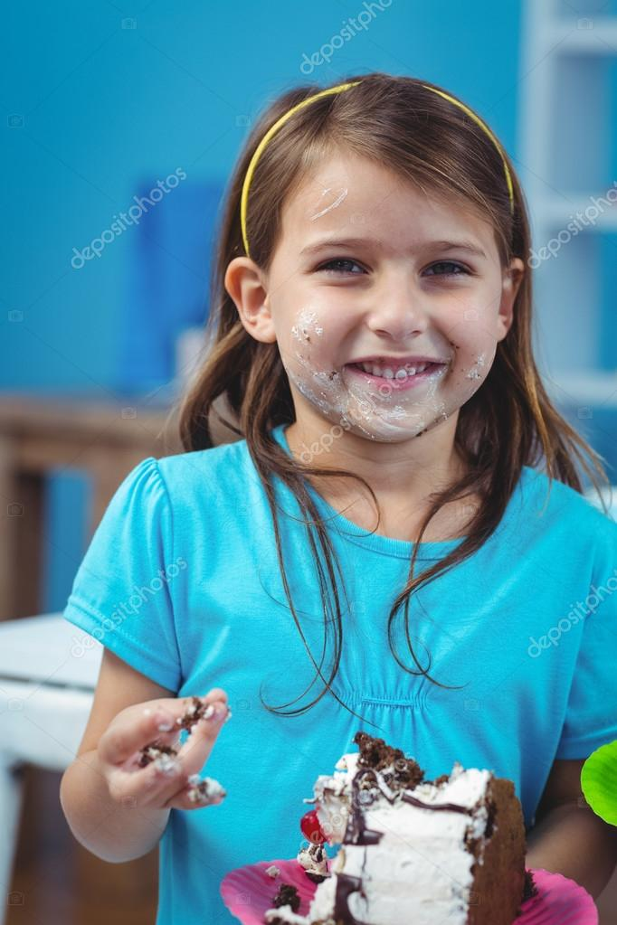 Happy kid eating birthday cake Stock Photo Wavebreakmedia 90532418