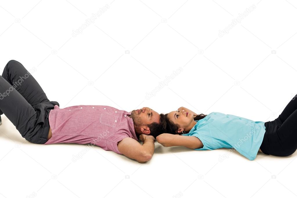Peaceful young couple laying on floor