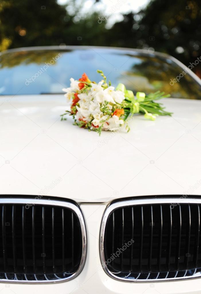 Bouquet of flowers on car hood