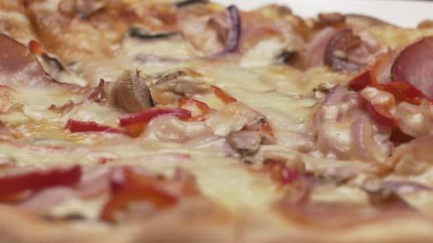 Rustic italian pizza with ham, kaiser, mozzarella and mushrooms