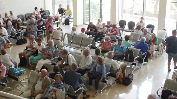 Passengers wait to board airplane in a waiting room at Danube Delta international airport
